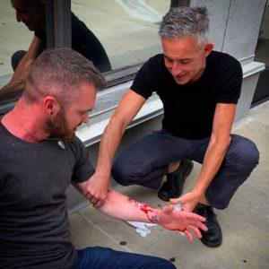 Dr Kroner practicing urban emergency care - tending to a bleeding classmate.